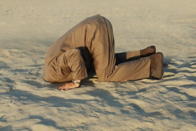 man head in sand 123rf